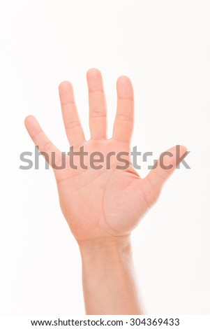 Man's hand making thumbs up isolated over white background. Adult man demonstrating his white palm.
