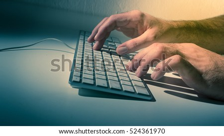 man's hand on computer keyboard