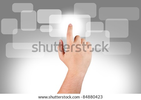 Man's hand pushing a button on monitor screen