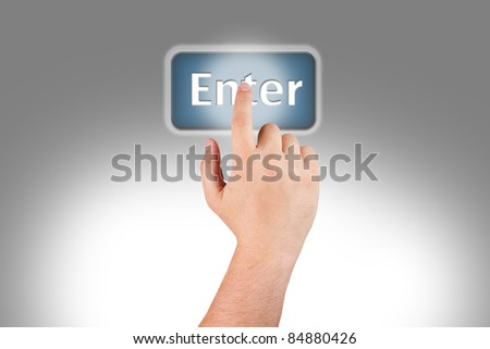 Man's hand pushing a Enter button on monitor screen