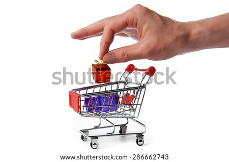 Man's hand putting a gift to shopping Cart