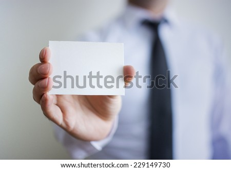 Man's hand showing blank card - stock photo