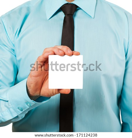 Man's hand showing business card - closeup shot on white background