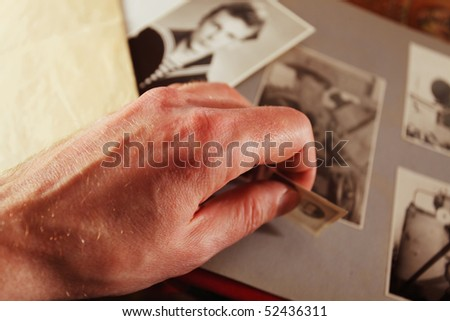 Man's hand with an old photo - stock photo