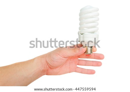 Man's hand with economical lamp. Lamp in a spiral pattern. Isolated on white background.