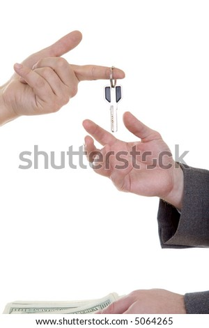 Man's hand with key isolated at the white background