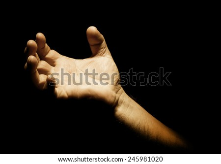 Man's hand with pain signal in dark background - stock photo