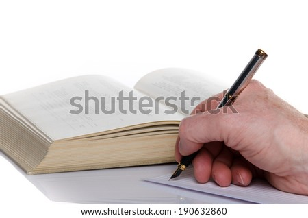 Man's hand writing on paper, isolated on white