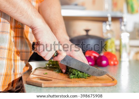 Man's hands cutting greenery