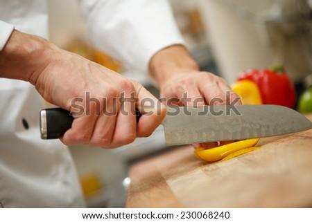 man's hands cutting pepper. Salad preparation - stock photo