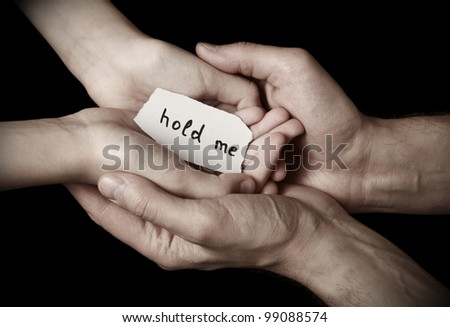 Man's hands hold children's hands - stock photo