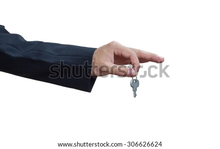 Man's hands in key - stock photo