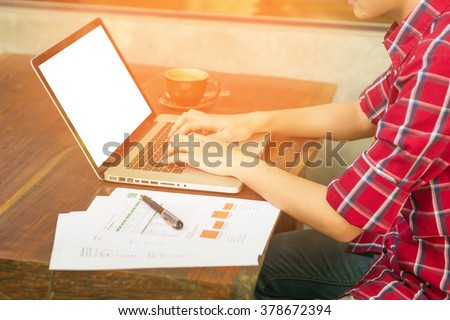 man's hands keyboarding on net-book while sitting at the wooden table in cafe,student working  laptop computer with copy space screen for your text ,male freelancer,vintage color. - stock photo
