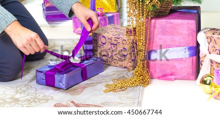 Man's hands preparing present and gifts for Christmas day - stock photo