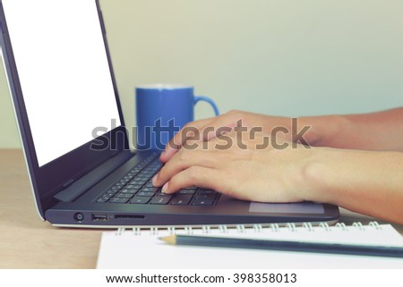 Man's hands using Laptop with blank screen to searching Furniture for Home interior.
