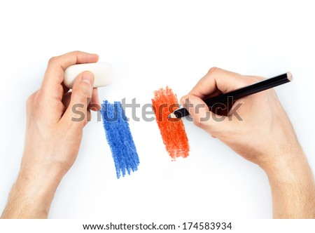 Man's hands with pencil draws flag of France on white background - stock photo