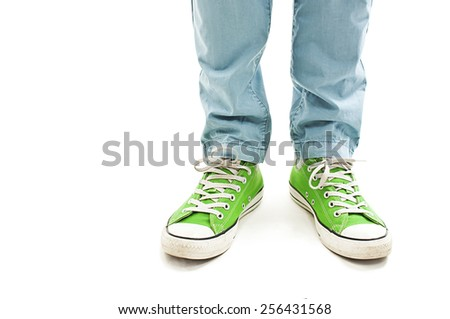 Man's legs in vintage green shoes. Isolated on white background