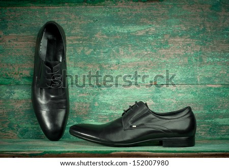 Man's shoes on wooden background  - stock photo
