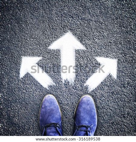 Man's shoes with three arrows directions, concept - stock photo