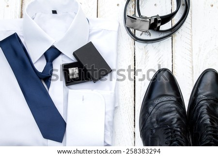 Man's style accessories. Composition on white wooden board - stock photo