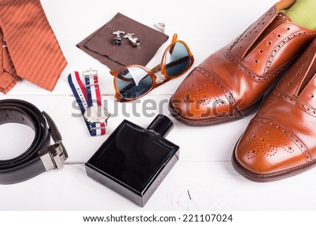 Man's style, urban shoes, socks and accessories on wooden table