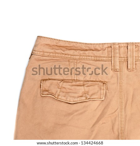 Man's trousers on white background showing rear pocket - stock photo