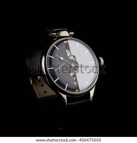 Man's watch on black background. Luxury goods. Black&White dial