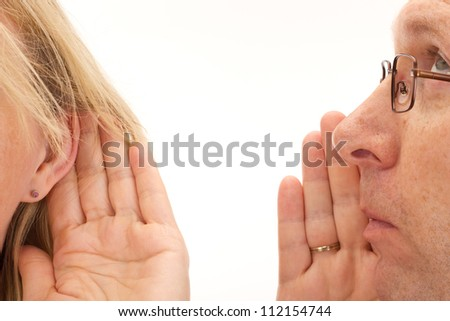 Man saying something to woman - stock photo
