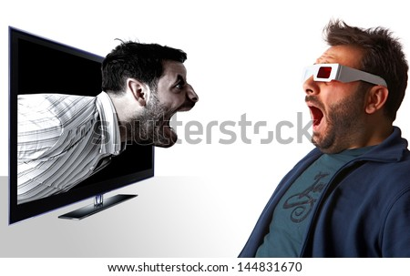 Man scared by a monster on television - stock photo