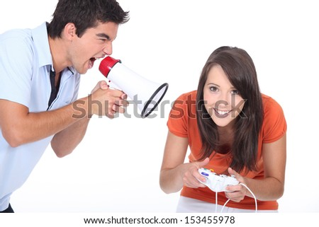 Man screaming at girlfriend - stock photo