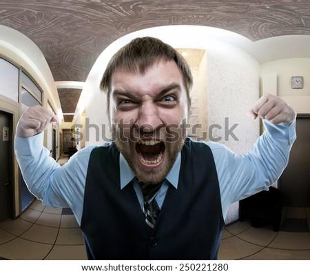 Man screaming at office - stock photo