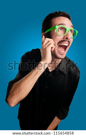 man screaming at the telephone on blue background