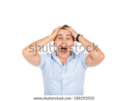man screaming mouth open, hold head hand, wear casual blue shirt, isolated white background, concept face emotion - stock photo