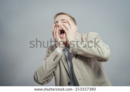 Man screaming with a big headache and cover his eyes - stock photo
