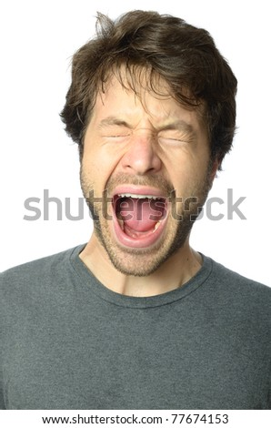 Man screaming with mouth wide open.