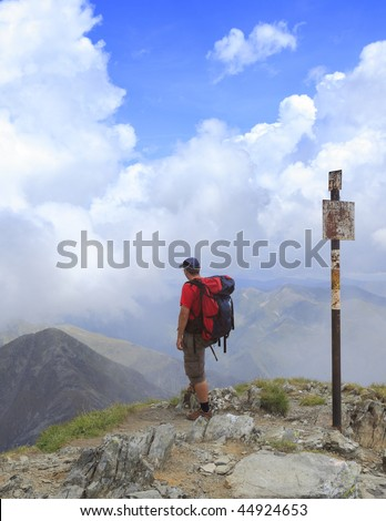 Man scrutinizing the horizon in mountains.