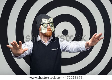 Man sees money. He is looking for money. A man with glasses who before the eyes of US 100 dollar bills.