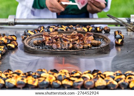 Man selling chestnuts in Istanbul  - stock photo