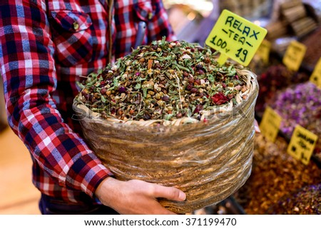 Man selling dry relax tea - stock photo