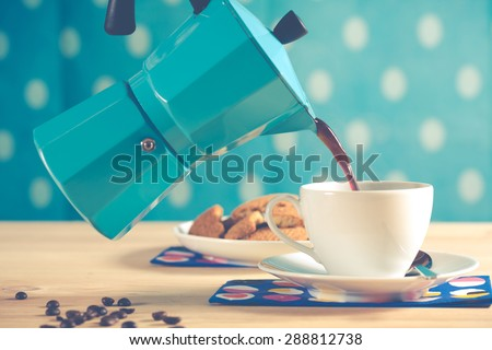 Man serving coffee with vintage coffee - stock photo