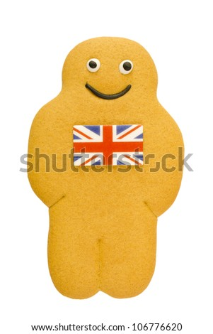 Man-shaped gingerbread with union flag icing on chest on a white background. - stock photo