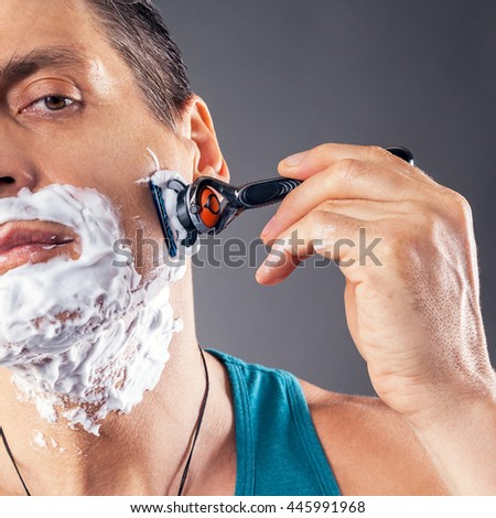 man shaves - stock photo