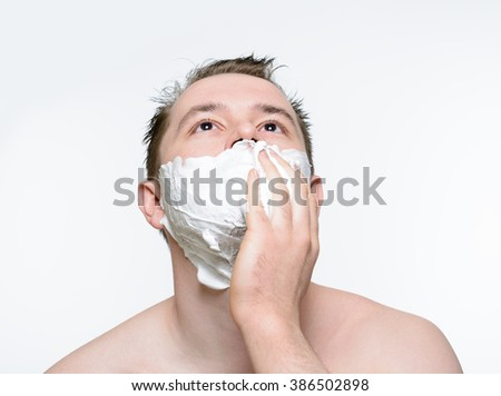 Man shaves shaving foam on a white background