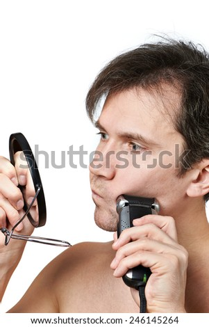 Man shaving face with electric razor on white background - stock photo