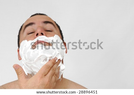 man shaving isolated on gray background