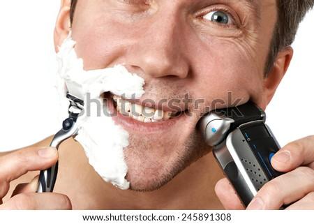Man shaving with two razors - stock photo