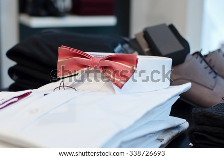 Man shirt with bow tie in a luxury clothing store.