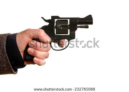 man shooting a handgun on the white background - stock photo