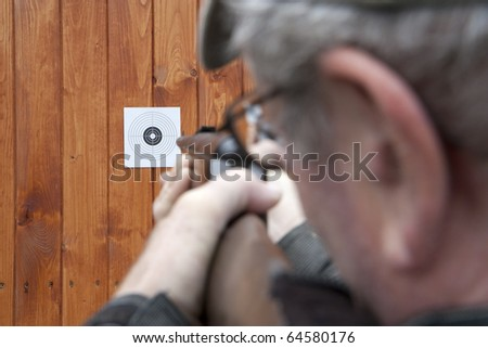 Man shooting with air gun - stock photo