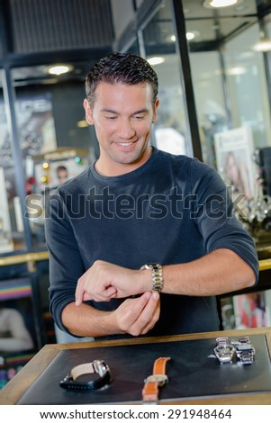 Man shopping for a watch - stock photo